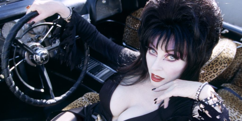 [INTERVIEW] Elvira, Mistress Of The Dark Talks Halloween, Cats, and Vincent Price
