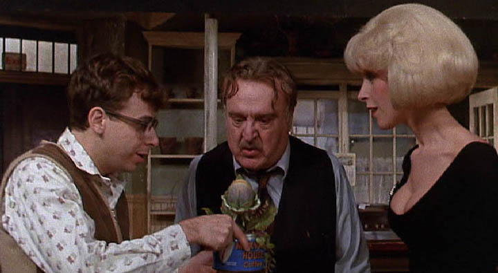 Seymour, Mushnik, and Audrey look at the root of their success and problems in LITTLE SHOP OF HORRORS (1986)