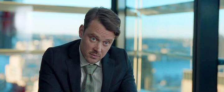 THE INVISIBLE MAN (2020) Michael Dorman as Pompous Jerk, Esq