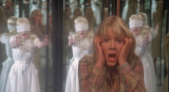 THE WATCHER IN THE WOODS (1980) Lynn-Holly Johnson is looking at the women in the mirror