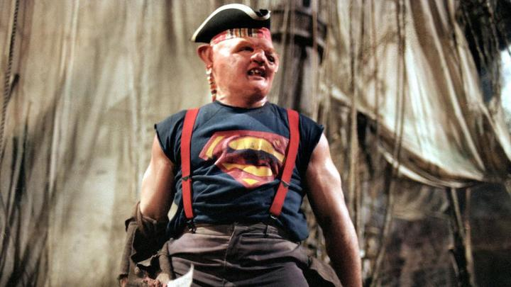 THE GOONIES (1985) John Matuszak as Sloth. Look, I know it's pretty fucked up. But it's also kind of a bad ass moment. He's a He-Man in Superman outfit with a pirate hat fighting his evil crim